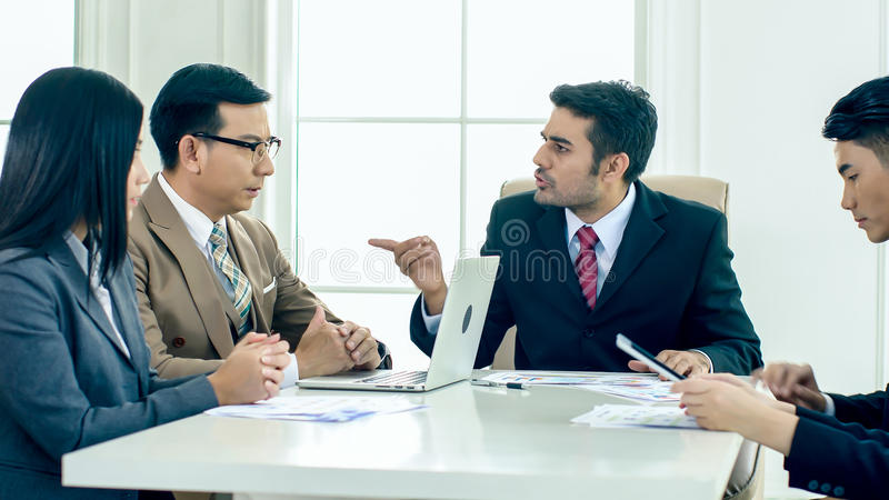 The executive director has upset in the meeting. The executive director has upset when looking report and found fault the Operation error and ask for royalty free stock photo