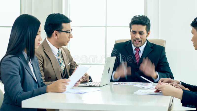 The executive director has upset in the meeting. The executive director has upset when looking report and found fault the Operation error and ask for stock photo