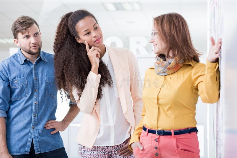 Executive director and her subordinates. Picture of female mature executive director and her subordinates royalty free stock image