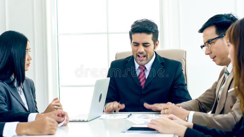The executive director strain and complain in the serious meeting. The executive director has upset when looking document report and found fault the Operation stock image