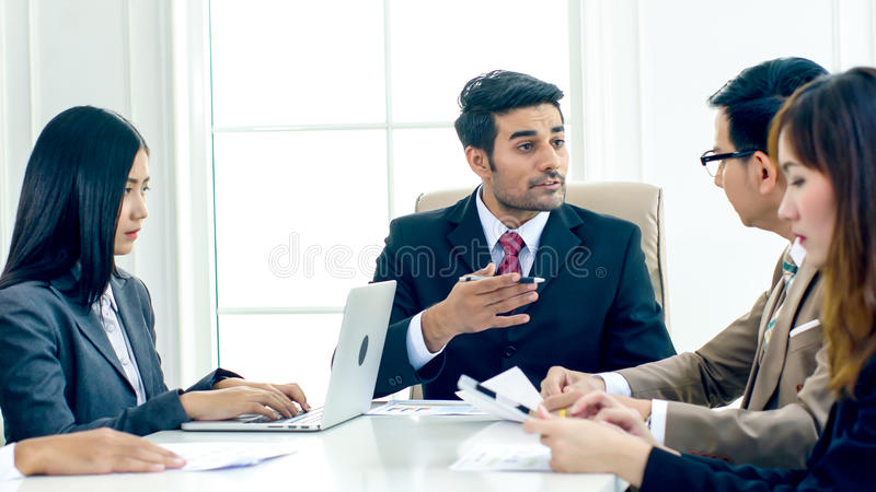 The executive director strain and complain in the serious meeting. The executive director has upset when looking document report and found fault the Operation royalty free stock photography