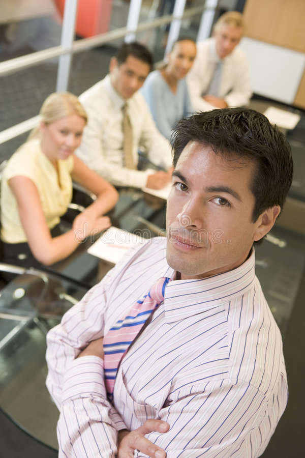 Executive at head of boardroom table royalty free stock images