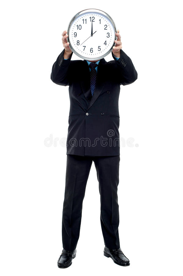 Download Executive Holding Up Wall Clock In Front Of His Face Stock Image - Image: 28251479