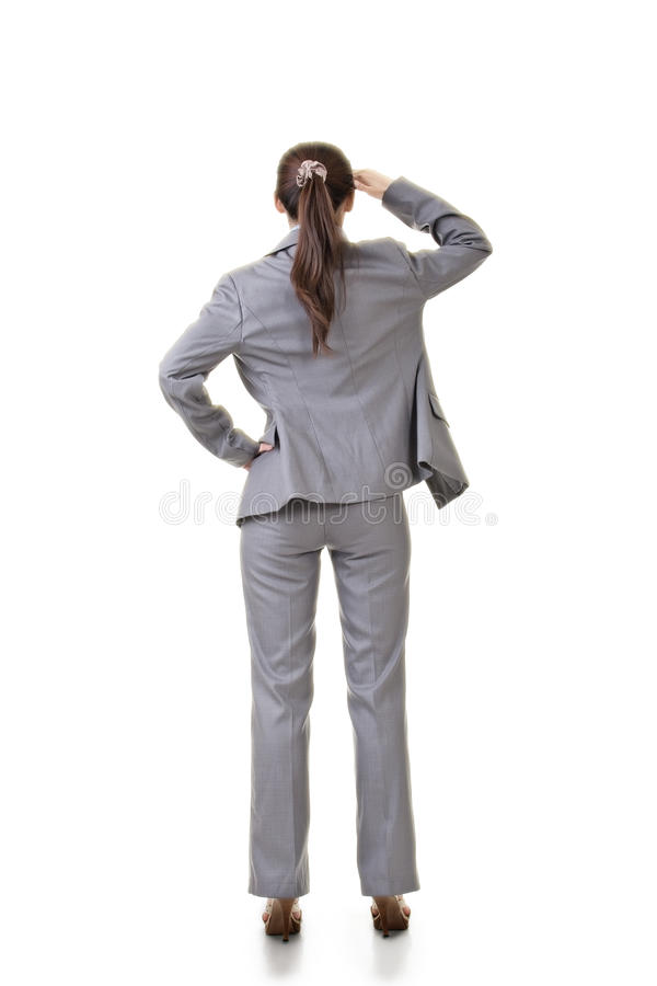 Executive look into distance, rear view stock photo