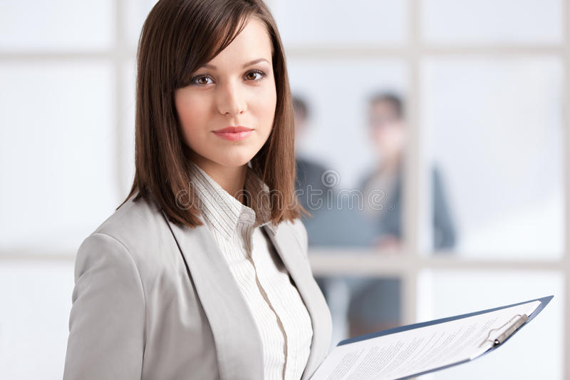Executive with pad on the glass wall background. Executive with tablet on the glass wall background with people royalty free stock photo