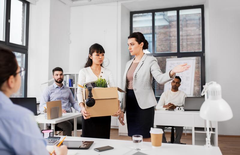 Executive seeing off fired female office worker royalty free stock photo