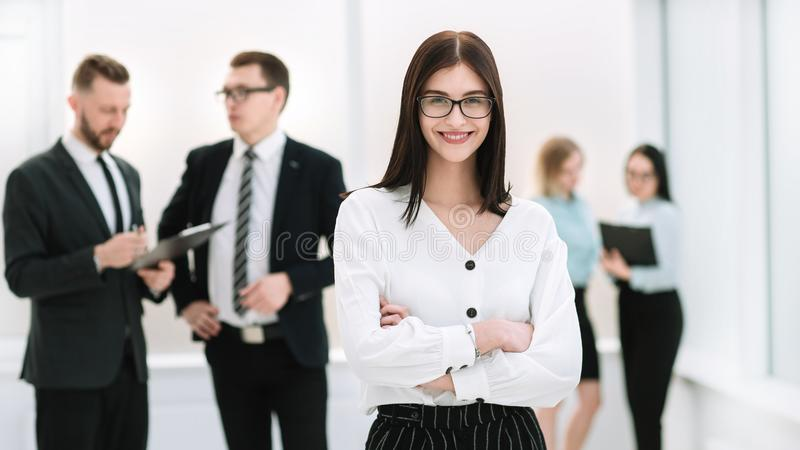 Executive serious businesswoman standing in the lobby office. Photo with copy space royalty free stock photos