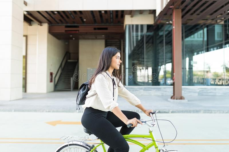 Executive Taking Bicycle To Work royalty free stock photography