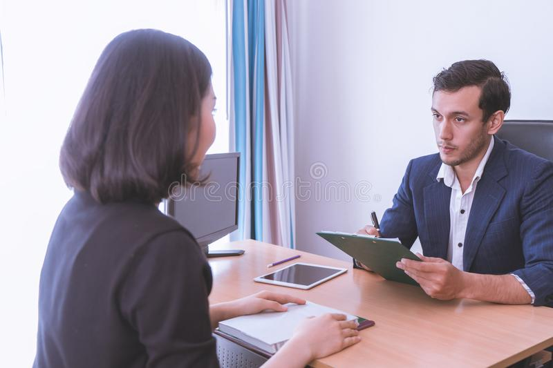 Executive taking note in business job interview royalty free stock images