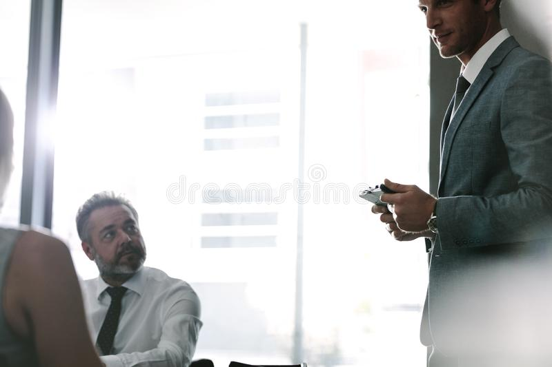 Executive talking with colleagues during a meeting royalty free stock images