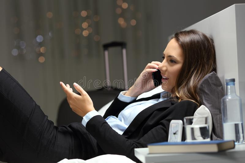 Executive talking on phone during a business travel royalty free stock photography