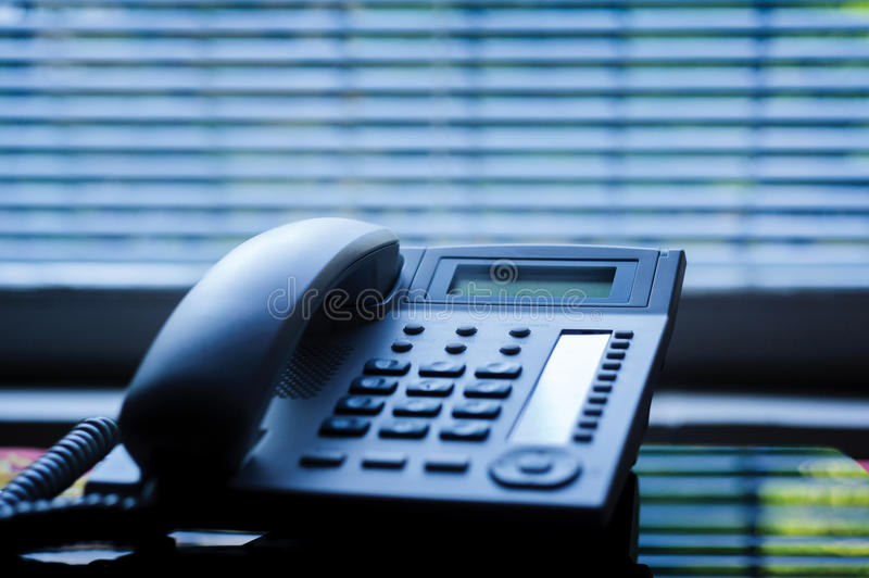Executive VoIP desk phone with traditional corded headset royalty free stock images