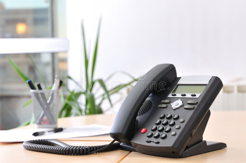 Executive VoIP Phone. On a beech desk