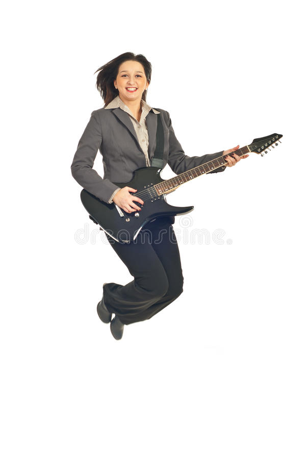 Executive Woman Jumping With Guitar Stock Images