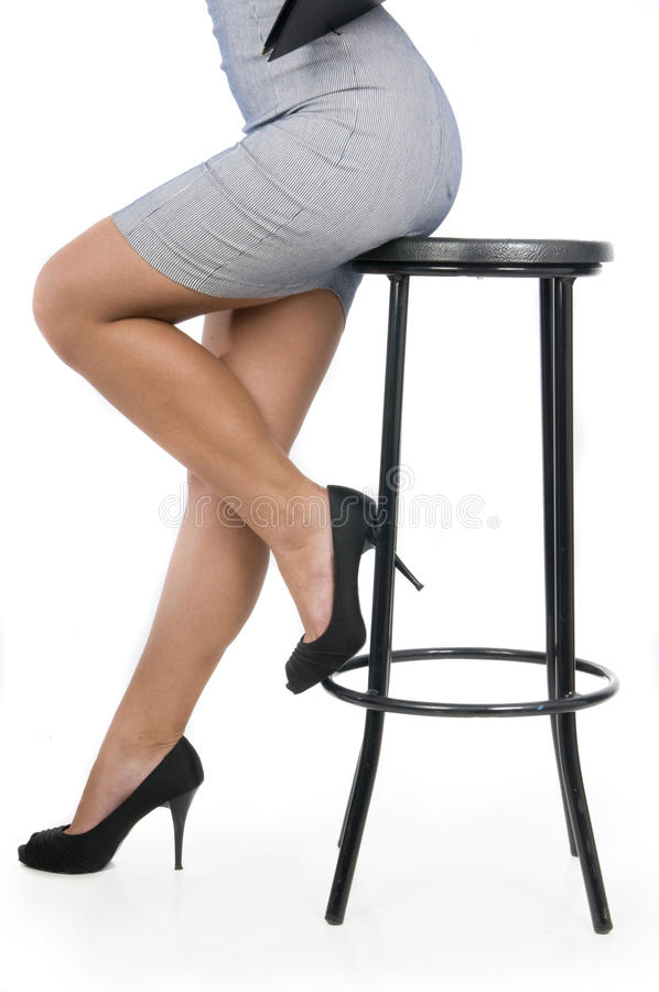 Executive woman legs in a chair royalty free stock photos