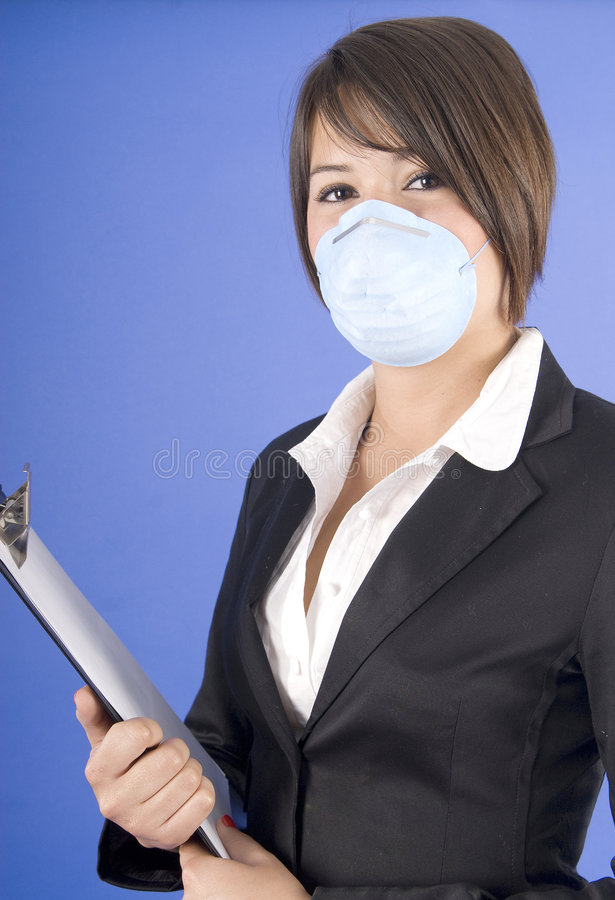 Executive woman with mask for swaine flu or others stock photo