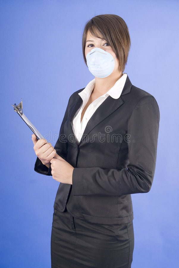 Executive woman with protective mask for swine flu royalty free stock photos
