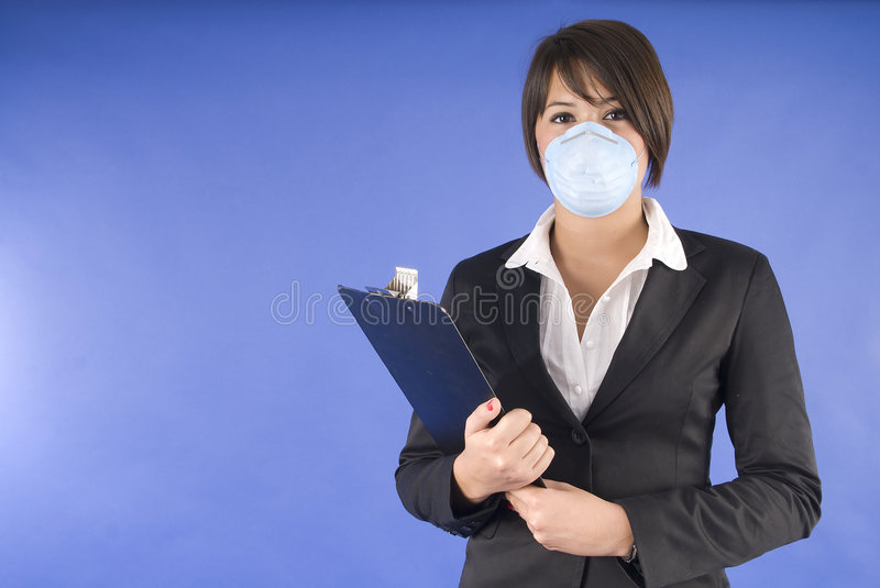 Executive woman with protective mask for swine flu stock images