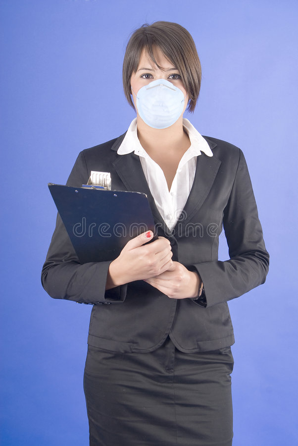 Executive woman with protective mask for swine flu stock photography