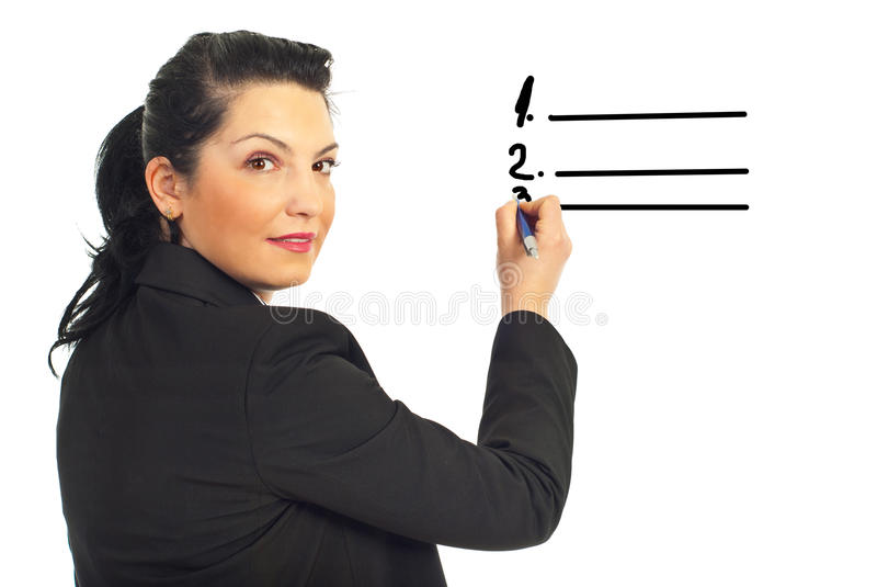 Executive woman writing on white space stock photography