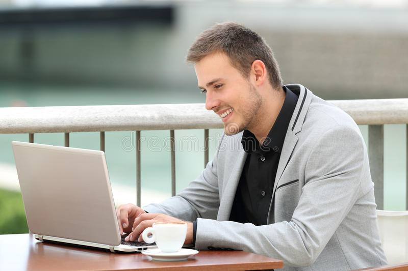 Executive writing in a laptop outdoors stock photography