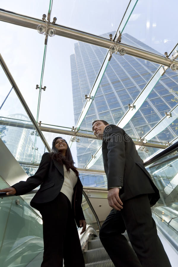 Download Executives on an Escalator stock image. Image of woman - 9805743