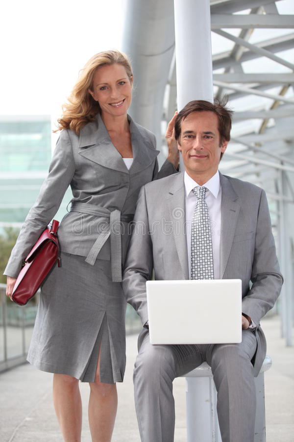 Executives with laptop computer stock images