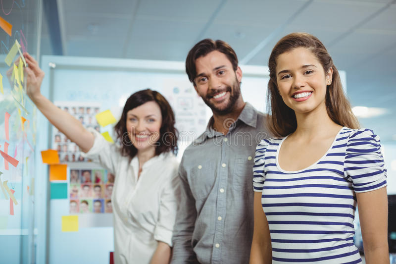 Executives team standing in office. Portrait of executives team standing in office royalty free stock image