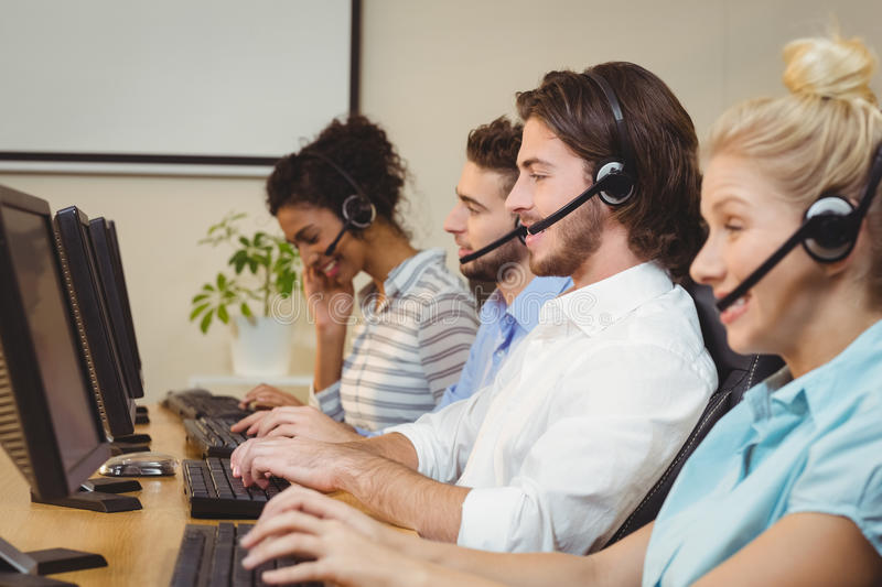 Executives working in call center. Wearing headsets royalty free stock photos
