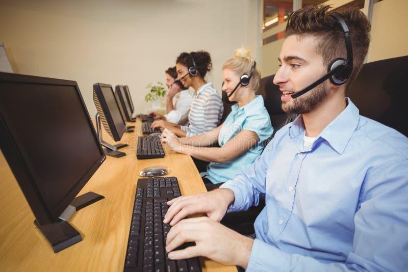 Executives working in call center stock photos