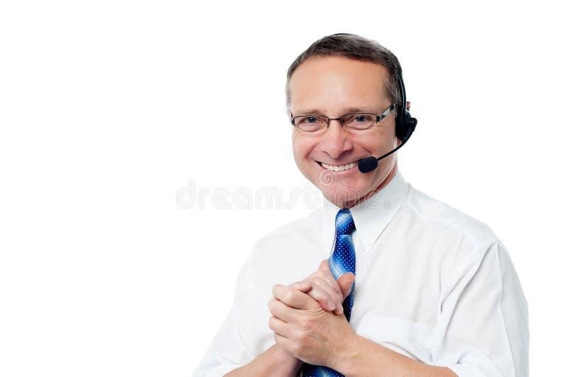 Executivo de sorriso do apoio ao cliente fotografia de stock