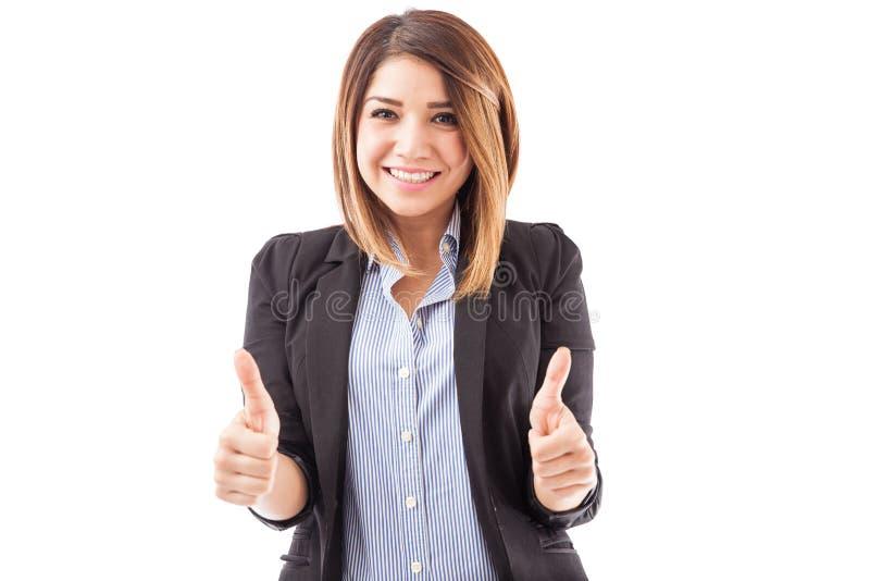Executivo fêmea com ambos os polegares acima fotografia de stock