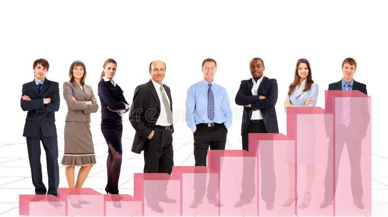 Executivos da equipe e o diagrama foto de stock