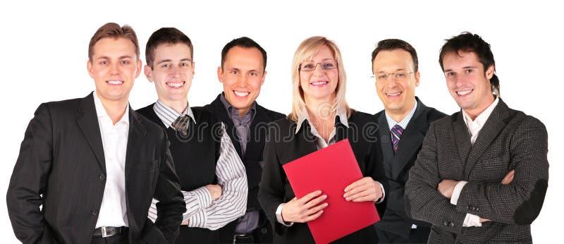 Executivos de sorriso do grupo das faces imagem de stock royalty free