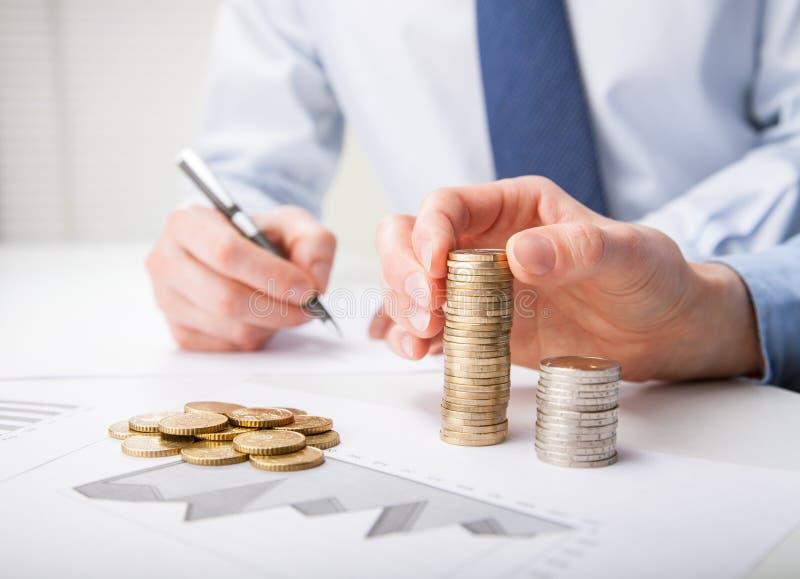Executivos do lucro calculador foto de stock royalty free
