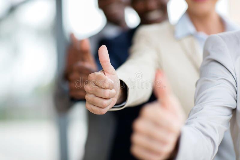 Executivos dos polegares acima foto de stock royalty free