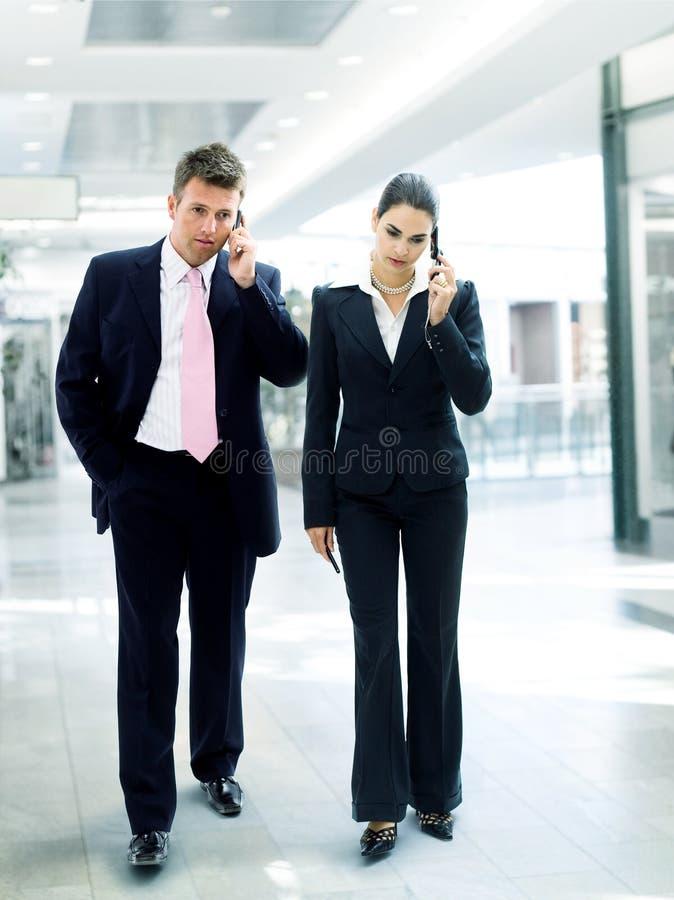 Executivos ocupados imagens de stock