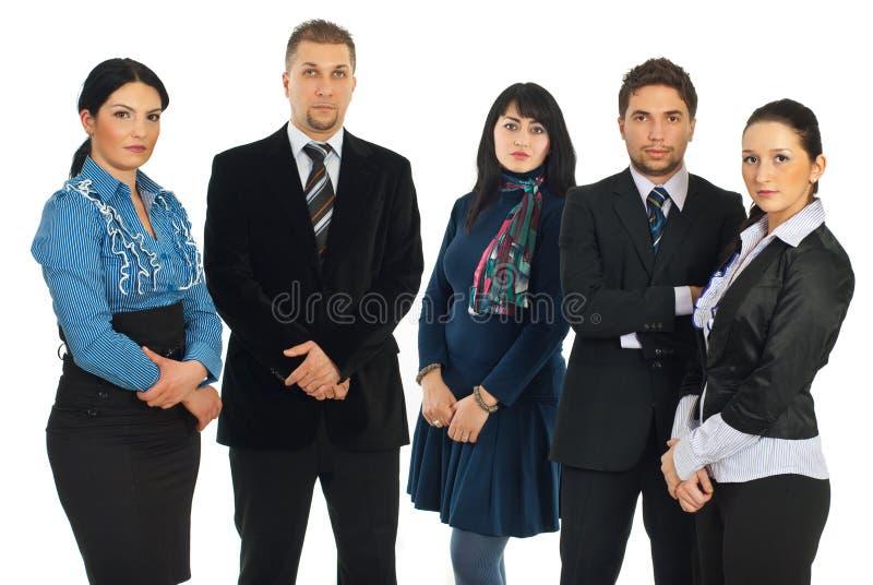 Executivos tristes em uma fileira imagens de stock