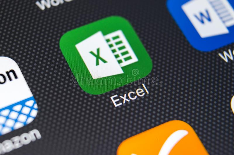 Exel application icon on Apple iPhone X screen close-up. Exel app icon. Microsoft office on mobile phone. Social media royalty free stock photography