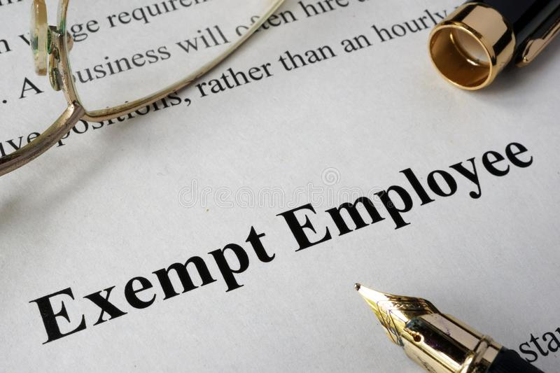 Exempt employee concept written on paper. Exempt employee concept written on a paper royalty free stock images