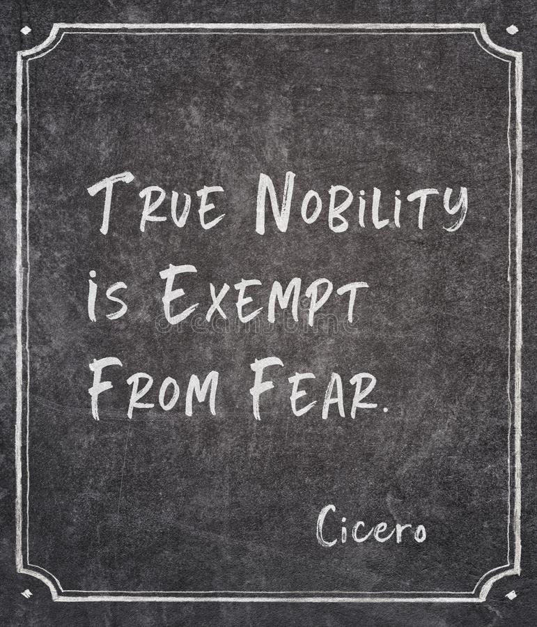 Exempt from fear Cicero quote. True nobility is exempt from fear - ancient Roman philosopher Cicero quote written on framed chalkboard royalty free stock image