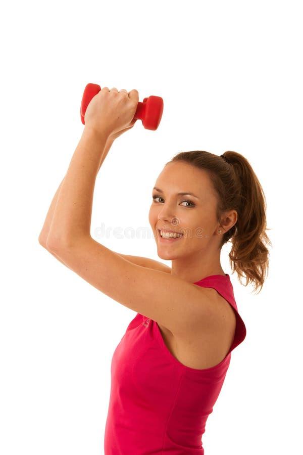 Exercício apto da mulher do active novo bonito com os pesos isolados sobre o fundo branco - aptidão fotos de stock