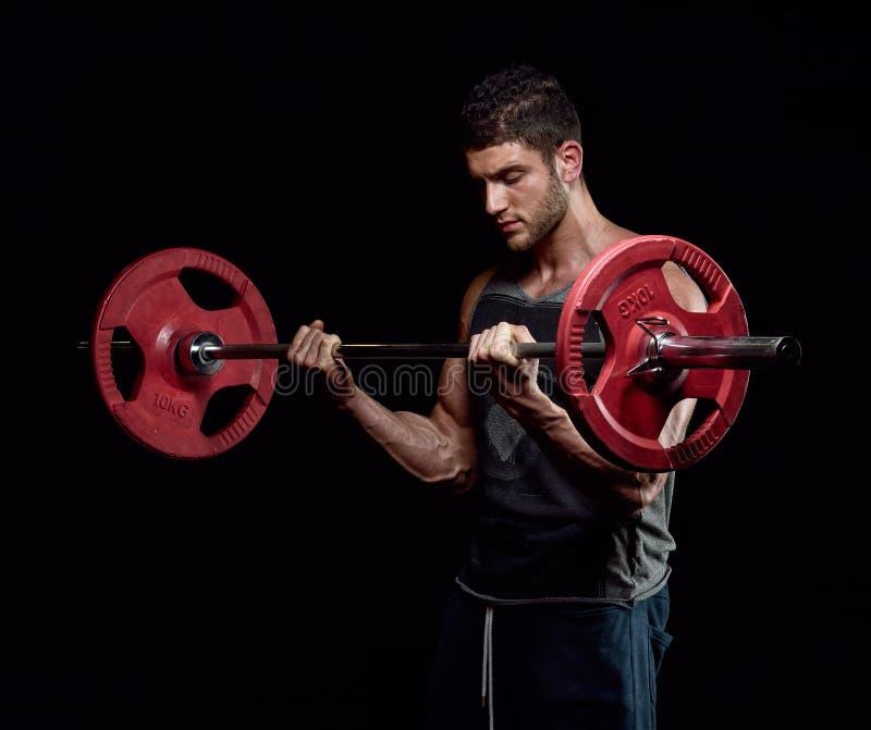 Exercício atlético do homem novo imagem de stock royalty free