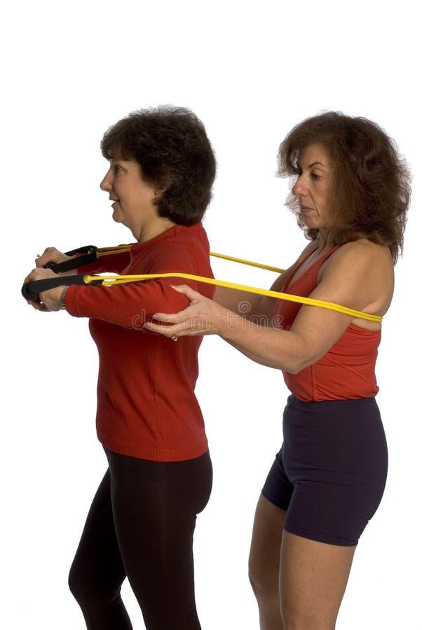 Exercício de duas mulheres fotografia de stock