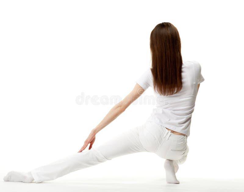 Exercício delgado da mulher nova foto de stock royalty free