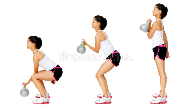 Exercício do dumbell de Kettlebell foto de stock