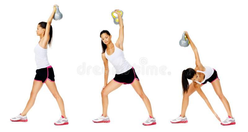 Exercício do dumbell de Kettlebell fotografia de stock