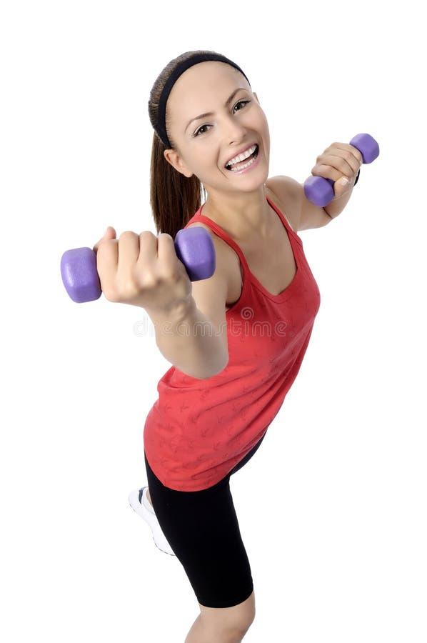 Exercício do peso da mulher do peso no gym fotografia de stock royalty free