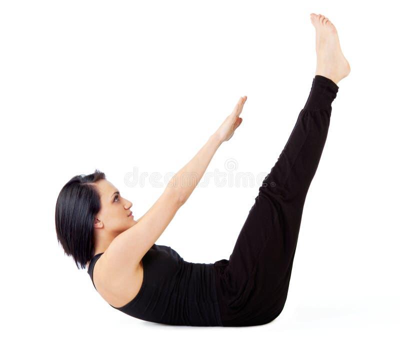 Exercício do sit-ups da mulher foto de stock royalty free