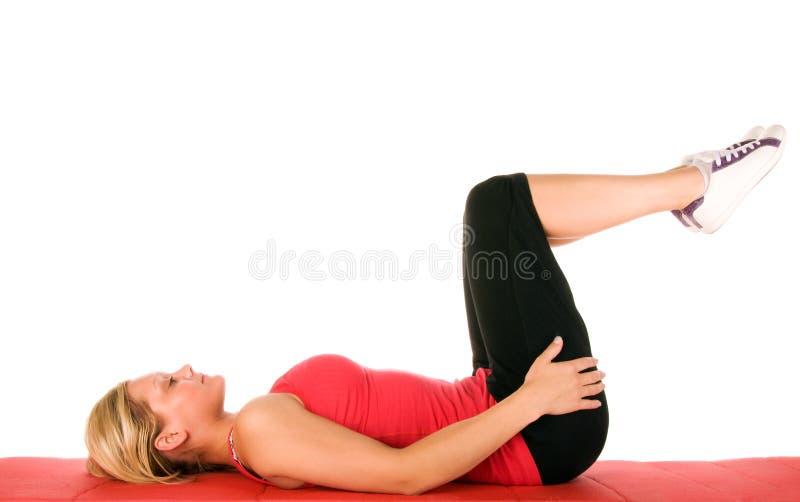 Exercício louro bonito das mulheres imagens de stock